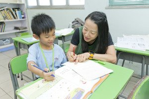 Teachers help children tackle difficulties and stimulate their interest in learning.